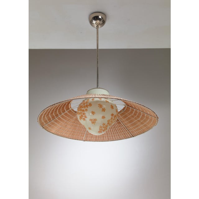 Gunilla Jung-Pircklén designed this model 1032 pendant lamp for Orno in 1935. The opaline glass diffuser is mouth blown...