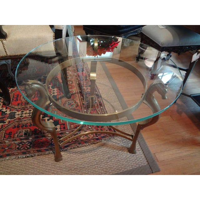 Round Italian Brass Table With Seahorse Head Supports And Glass Top - Seahorse coffee table