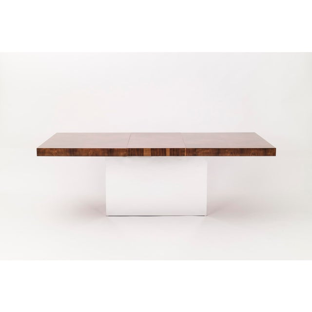 Milo Baughman for Thayer Coggin. Dining table with diamond patterned book-matched veneer and chrome-plated pedestal base....