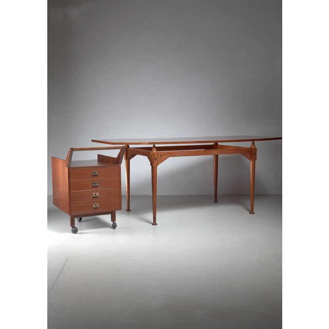A teak veneer and walnut model TL3 desk or table by Franco Albini for Poggi. Designed in 1951. The desk comes with a...