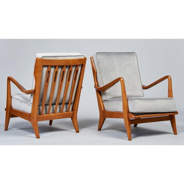 Gio Ponti (1891 - 1979). A rare and masterful pair of sculptural armchairs by Gio Ponti for Cassina, with sinuously carved...