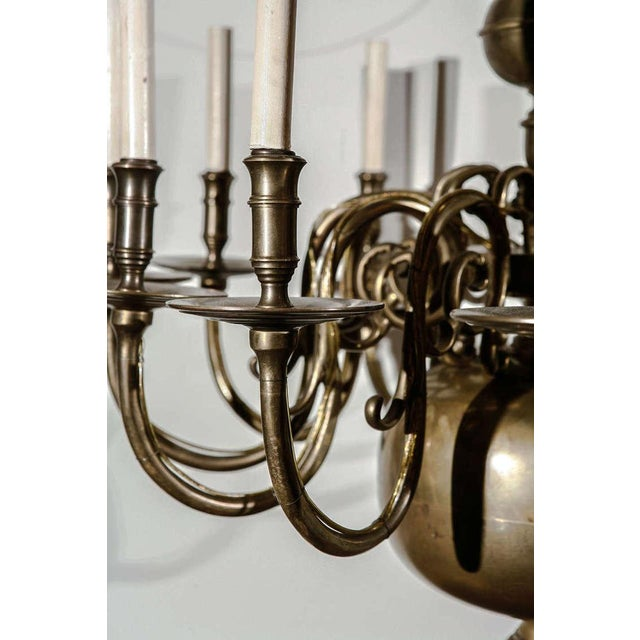 This antique 12 light chandelier is thought to be Dutch, from the earlier part of the 19th Century. It has been French...