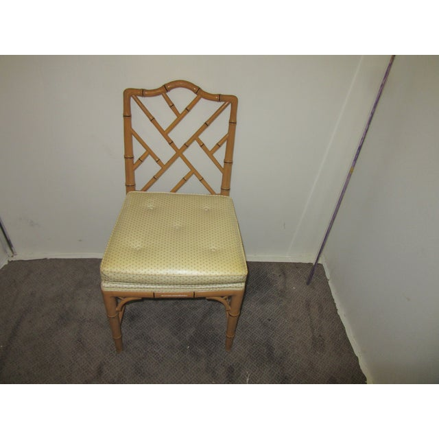 Set of 6 Hollywood Regency style Faux Bamboo dining chairs. The chairs retain their original natural finish. Seats are...