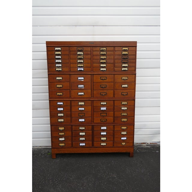 This Unique Large Stacked File Cabinet is made of wood, solid wood, solid Oak and Tiger Oak, and is in good condition....