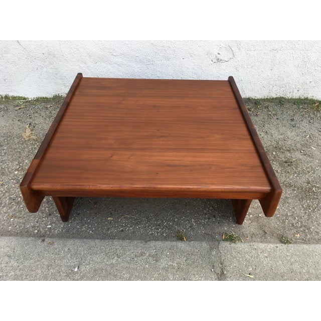 Gorgeous solid walnut coffee table by Brown Saltman and design by John Keal. The gorgeous solid walnut construction is...