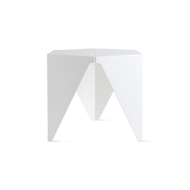Designed by Isamu Noguchi, produced by Vitra. The Prismatic Table is based on purely geometric forms. This novel three-...
