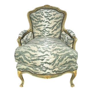 French Bergère Chair, Carved and Painted in Ivory and Celadon Newly Upholstered For Sale