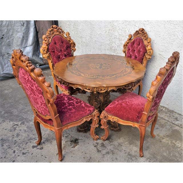 Outstanding Italian round dining table and 4 Chairs. High rococo revival style design is showcased on this exceptionally...