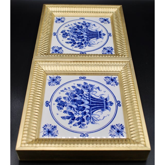 A lovely pair of Mid-20th Century Dutch Delft Floral Tiles. Unique, one of a kind frame design. Golden gilt wood frame,...