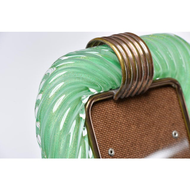 Circa 1940s Murano glass table top picture frame by Barovier and Toso. Heavy, clear ribbed glass in spring green with gold...