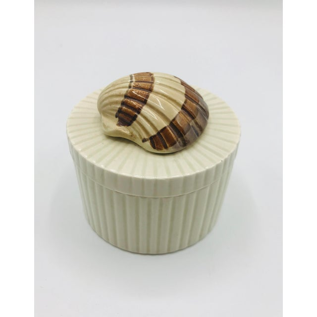 A vintage ceramic Fitz and Floyd seashell box with lid. This pretty contemporary box is perfect for small items, or...