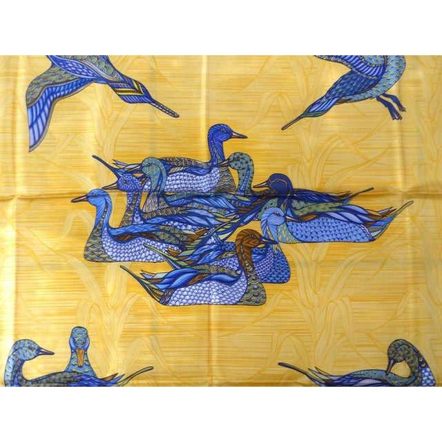 """Offered for sale is an unused Hermès silk scarf titled """"La Mare aux Canards"""" by Daphne Duchesne in 1981. This scarf..."""