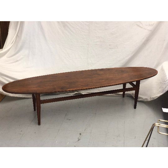 Vintage coffee table by Henredon made from Walnut Wood. A perfect addition for any living room.