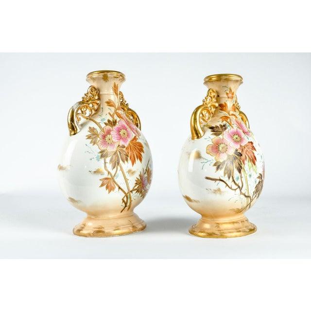 Antique pair German royal bonne porcelain vases / decorative pieces. Each piece is in excellent antique condition. Each...