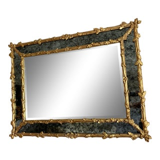Giltwood and Antiqued Glass Wall Mirror For Sale