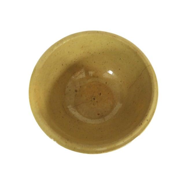 "Antique stoneware bowl. Light yellow glaze. Measures 8"" across top and 3 1/2"" deep."