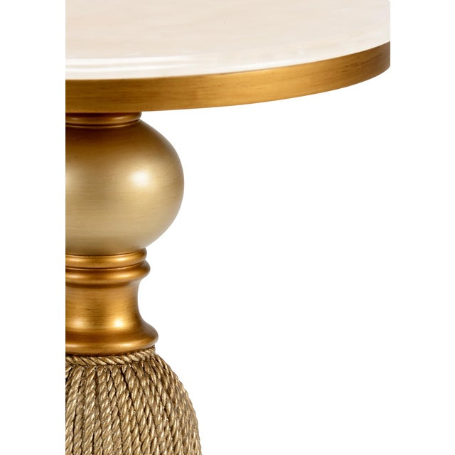 This is a gold leaf finished side table by Chelsea House Inc. The piece is made of wood and composite, featuring a cream...