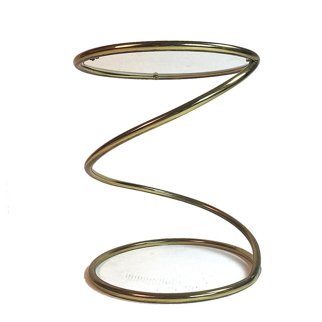 """Small """"spring"""" table made by Pace, circa 1970s. Brass frame with glass top inset."""