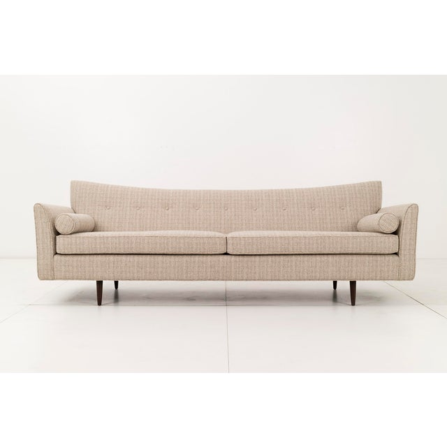 """Pagoda like shaped back. Upholstered with new foam cushions and bolsters in Knoll """"Keaton"""" fabric. Solid walnut legs."""
