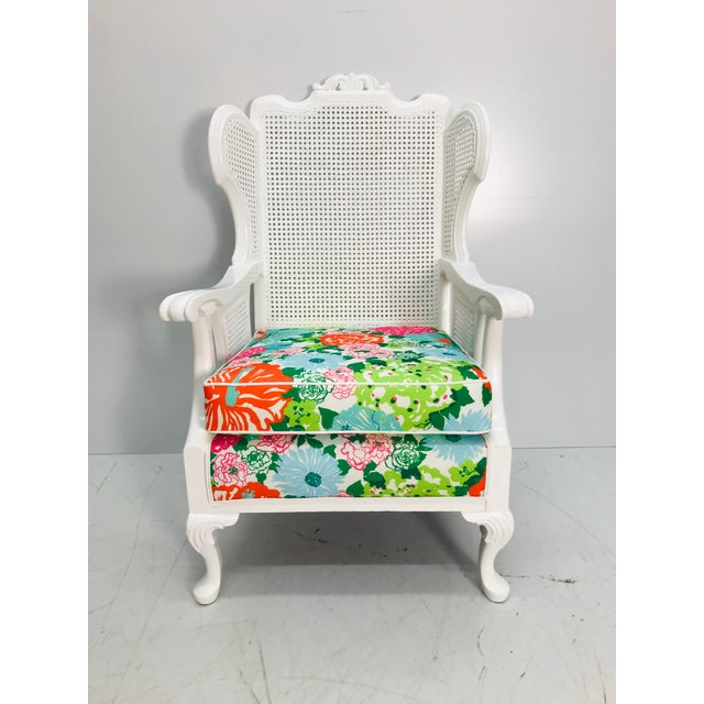 Vintage caned wingback chair with a bright floral Lilly Pulitzer outdoor fabric that is water, stain and fade resistant....