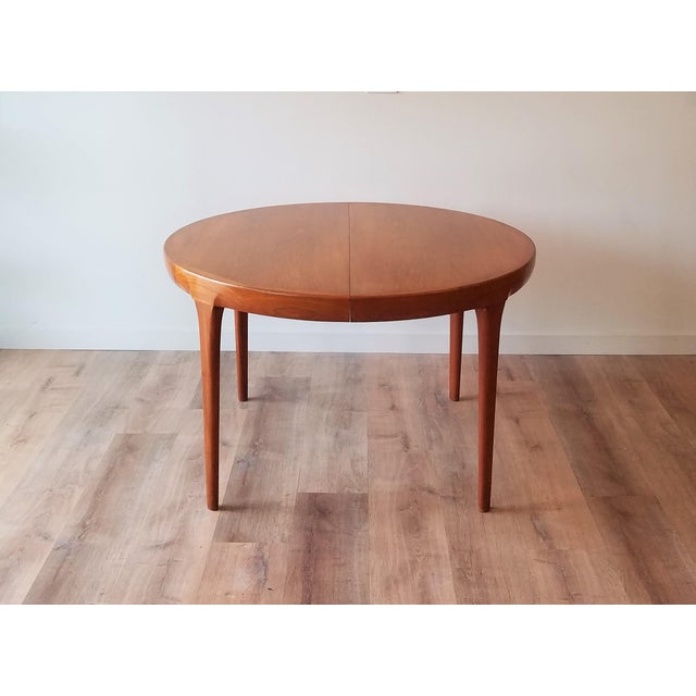 """Kofod Larsen teak circular extendable dining table designed for Faarup Møbelfabrik with two 19.5"""" leaves that fully extend..."""