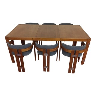 Teak Dining Set With Chrome Accents, Table With Self Storing Leaf and Six Matching Chairs For Sale