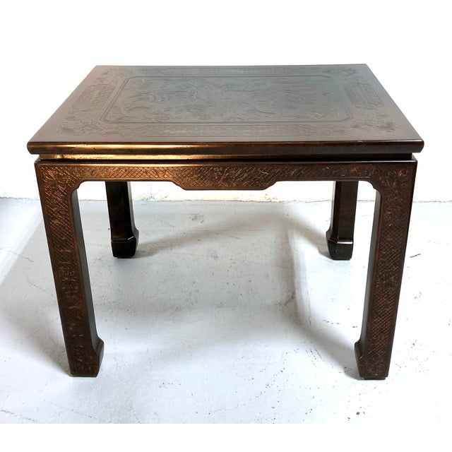 A Mario Buatta for John Widdicomb chinoiserie coffee table, 1980. Faux tortoise shell finish with finely detailed incised...