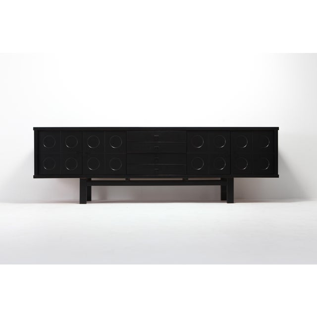 Graphical sideboard made out of ebonized oak. The symmetry of this design combined with the graphical pattern on the doors...