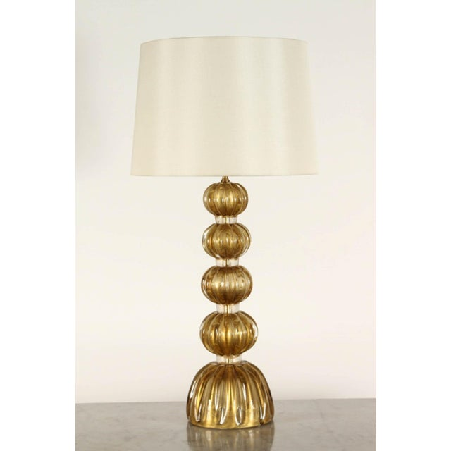 A pair of Murano glass lamps that are made by blown glass with an interior of gold foil. These classic Art Deco lamps...