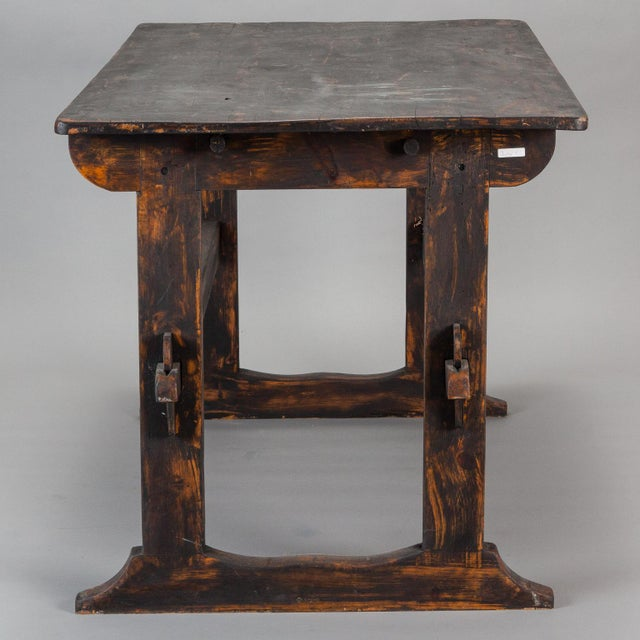 Late 18th century Swedish table set on a base of two trestles with double cross bars and smokey black painted finish....