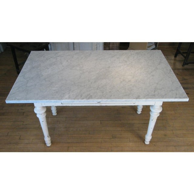 A gorgeous late 19th century painted refectory table with a beautiful Italian Venatino marble top. The table with a single...