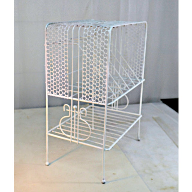 1960s metal music stand and storage table in white color. Middle section holds records with additional shelves for...