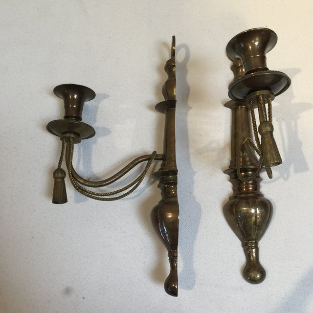 Pair of Elegant French Ormolu Louis XVI style sconces nicely cast tassel motif. Regency or Neo classical style wall...