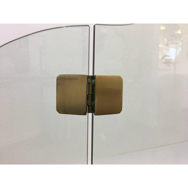 """A glamorous 1970s satin brass and 1/2"""" thick glass fireplace screen by Pace collection. Dimensions: 31.75"""" high 52.25""""..."""
