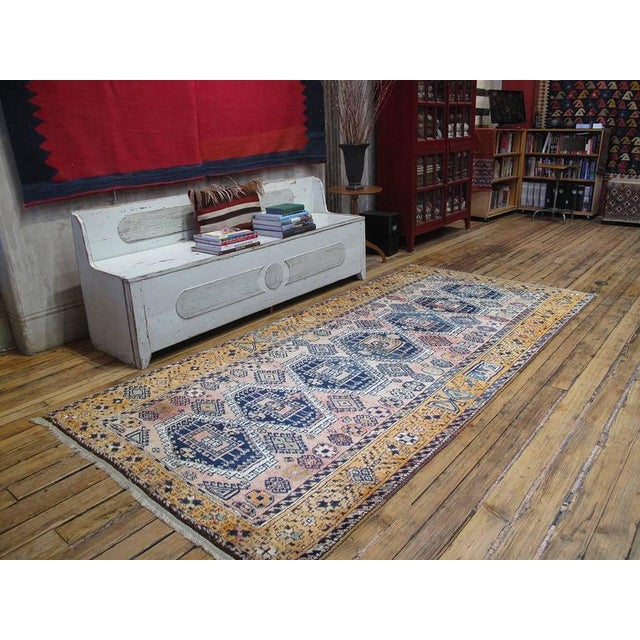 A lovely vintage Kurdish rug in the typical long format. Glossy wool, unusual color palette.