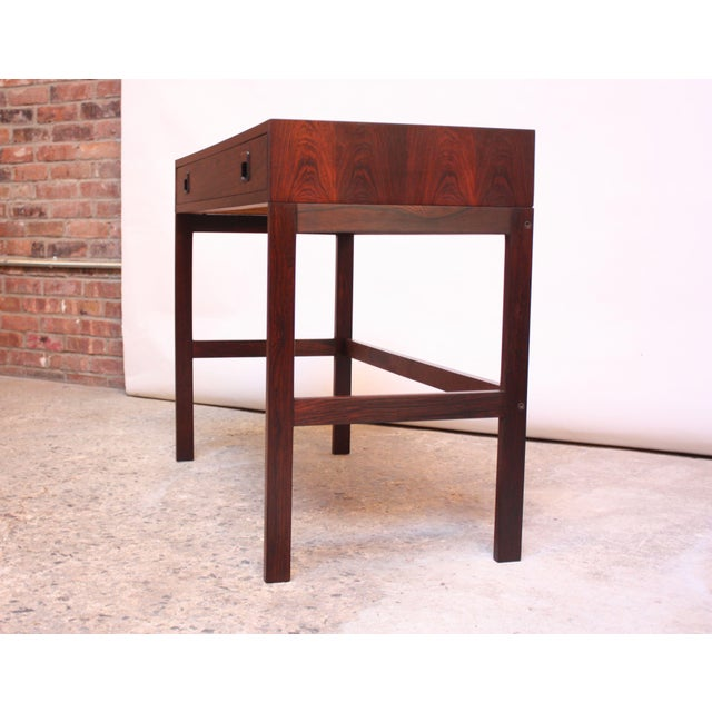 1960s Danish rosewood desk by EJM Skive Møbelfabrik. Elegant, minimal design with exquisitely book-matched top. Composed...