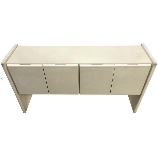 This piece, designed by Milo Baughman for Thayer Coggin in the 1970s, lacquered in a pale buttercream/ivory color, is in...
