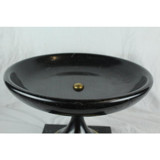 Black marble urn with gold accents at base. Could be used for an elegant birdbath on square pedestal.