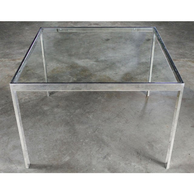 Handsome chrome and glass Parsons style end table attributed to Milo Baughman circa 1970. In wonderful vintage condition...