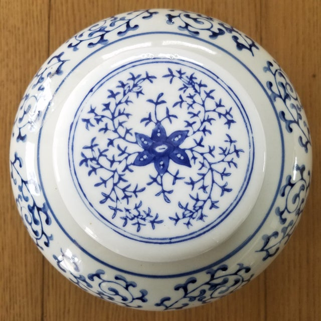 Lovely blue & white Chinoiserie ginger jar with a hand painted, classic vine motif. A wonderful piece to add with a...