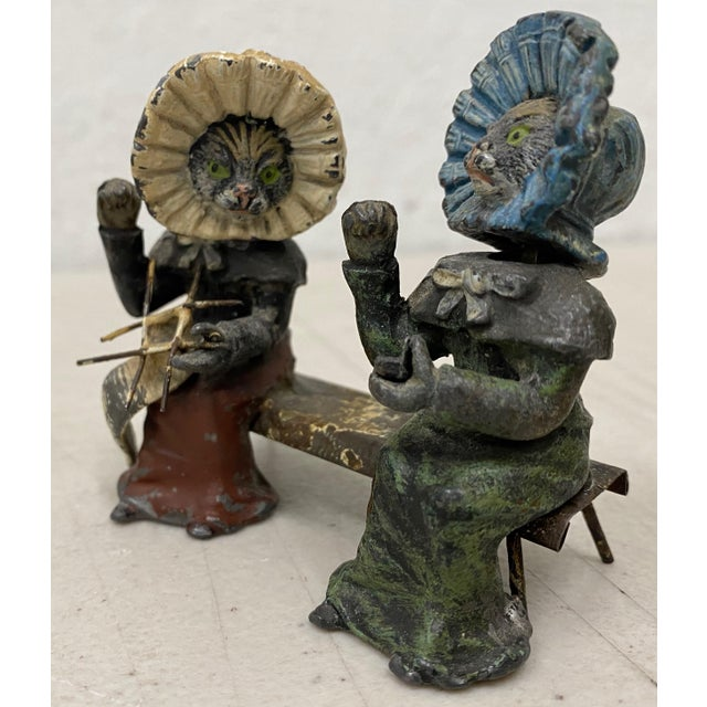 Rare 19th Century Georg Heyde Painted Metal Cats with Shaking Heads c.1890s A charming pair of ladies on a bench. One is...