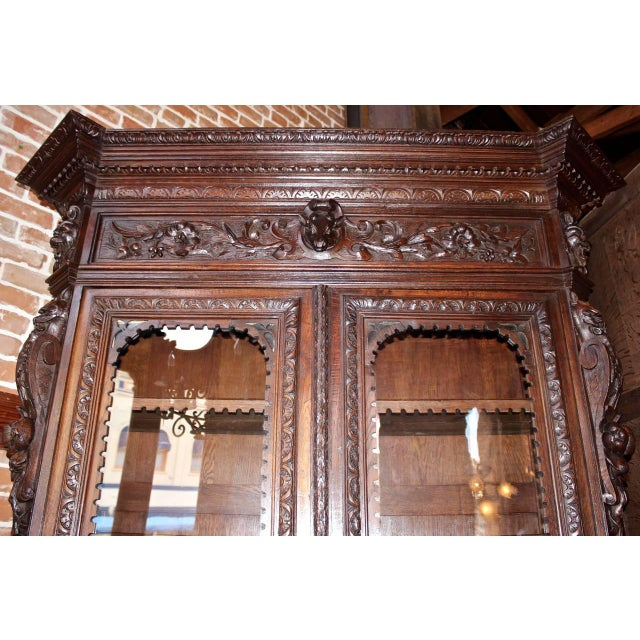 """This French bookcase is made in the ornately carved """"Hunt"""" style. Features carvings specific to the style. Storage..."""