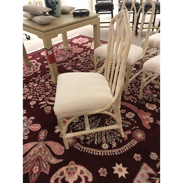 Beautiful rattan side chairs with Sherpa upholstery and off white painted finish. These chairs feature leather wrapped...