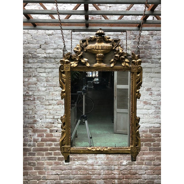 Louis XVI, carved gilt wood mirror, Provenance ,South of France This mirror is adorned with floral and foliate patterns....
