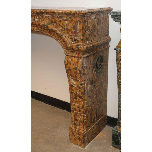 An early to mid 19th century louis xiv style mantel. It is medium sized, so it's appropriate for a bedroom or living room....