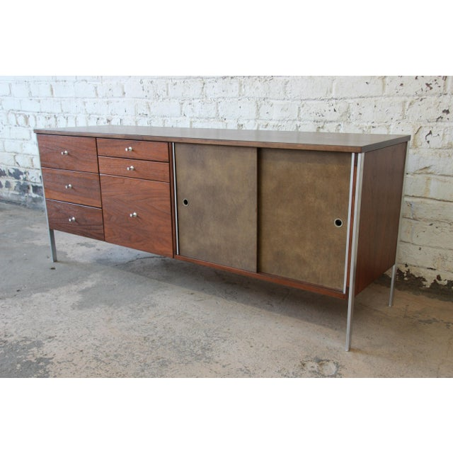 Offering a rare and exceptional mid-century modern walnut executive credenza designed by Paul McCobb for his Area Plan...
