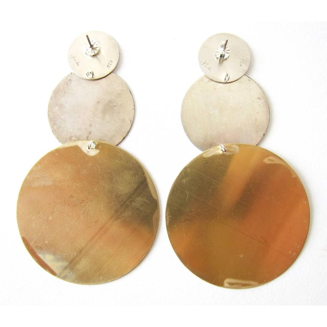 Oxidized sterling silver and brushed brass kinetic modernist earrings created by Heidi Abrahamson of Phoenix, Arizona....