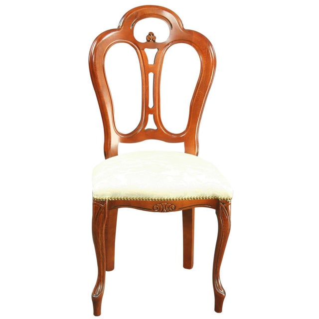 The mahogany frame of this elegant reproduction Rococo chair features a wonderfully shaped and pierced back with a lovely...