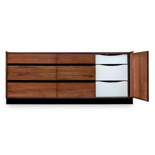 Mid-Century Modern walnut 9-drawer dresser by Merton Gershun for Dillingham's Esprit collection. Features: • Beautiful,...