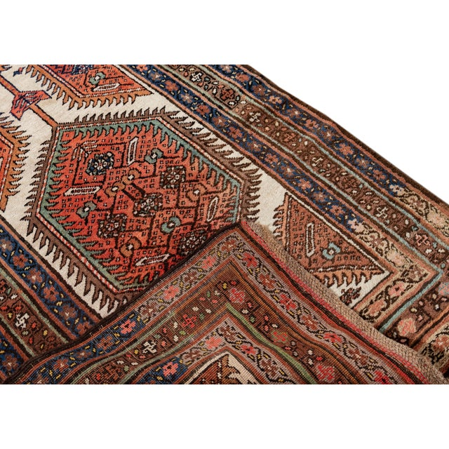 Beautiful Vintage Persian Long Runner Rug, with a rust field, ivory and blue accents in an allover medallion floral...